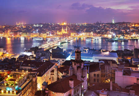 Istanbul, Turkey - March 12, 2014  Night view to Golden Horn bay and Galata bridge  Built in 1992, the bridge is now a place where the locals gather to fish, eat, drink, smoke and shop
