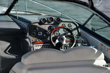 aftermarket: Dolgoprudny, Moscow region, Russia - July 4, 2014  steering wheel of a motor boat exposed on the 5th Yachts and Boats Fair  Water World   It