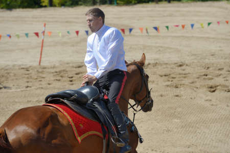 housed: Lytkarino, Moscow region, Russia - July 12, 2014  Sergey Murugov performs stunts during Russian championship in trick riding  Lytkarino housed the Russian Federation of trick riding