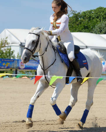 housed: Lytkarino, Moscow region, Russia - July 12, 2014  Maria Artishcheva performs stunts during Russian championship in trick riding  Lytkarino housed the Russian Federation of trick riding