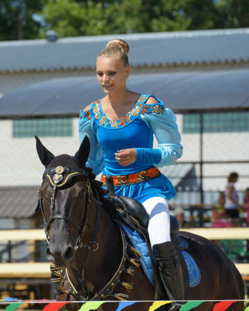 alexandra: Lytkarino, Moscow region, Russia - July 12, 2014  Alexandra Kalinina warms up her horse during Russian championship in trick riding  Lytkarino housed the Russian Federation of trick riding