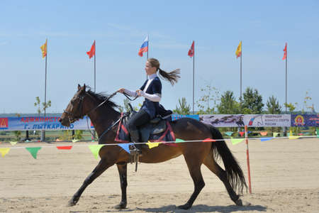 housed: Lytkarino, Moscow region, Russia - July 12, 2014  Victoria Dubasova performs stunts during Russian championship in trick riding  Lytkarino housed the Russian Federation of trick riding