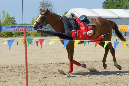 housed: Lytkarino, Moscow region, Russia - July 12, 2014  Anastasia Plavunova performs stunts during Russian championship in trick riding  Lytkarino housed the Russian Federation of trick riding