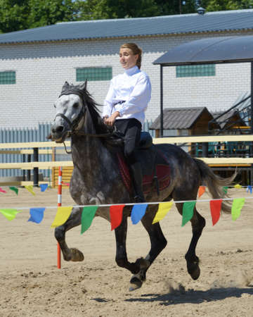 housed: Lytkarino, Moscow region, Russia - July 12, 2014  Maria Sidorova performs stunts during Russian championship in trick riding  Lytkarino housed the Russian Federation of trick riding