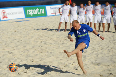shootout: Moscow, Russia - July 13, 2014  Andreas Aniko of Estonia performs penalty shoot-out in the match with Kazakhstan during Moscow stage of Euro Beach Soccer League  Kazakhstan won 3 2 after penalty shoot-out Editorial