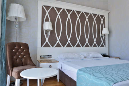Oludeniz, Turkey - March 30, 2014  Interior of a bedroom with double bed in the Ocean Blue High Class Hotel  This 4 star hotel offer to the guests 68 rooms, freeform swimming pool, restaurant, Turkish bath, and other features