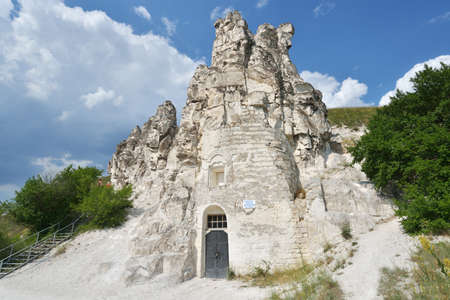 restored: Divnogorie, Voronezh region, Russia - June 8, 2014  People near the cave church of Sicilian Icon of the Mother of God  The church was found in XVII century, and last time restored in mid 1990s
