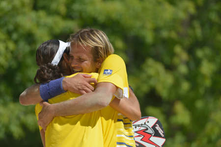 Moscow, Russia - July 19, 2014  Vinicius Font and Joana Cortez of Brazil celebrate the victory in the match against Spain during ITF Beach Tennis World Team Championship  Brazil won 2-1