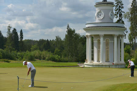 Tseleevo, Moscow region, Russia - July 24, 2014: Golfers warm up on the golf course in the Tseleevo Golf & Polo Club during the M2M Russian Open. This international golf tournament is the stage of the European Tour Editorial