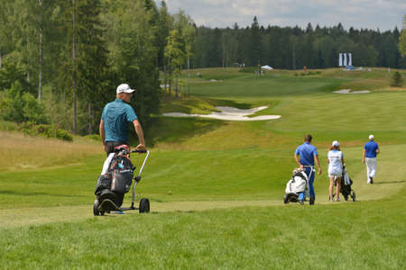 Tseleevo, Moscow region, Russia - July 24, 2014: Nikolaj Nissen of Denmark and other golfers on the golf course during the M2M Russian Open. This international golf tournament is the stage of the European Tour