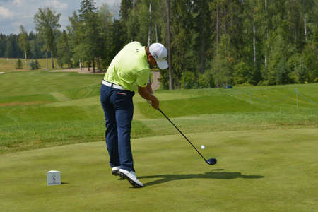 Tseleevo, Moscow region, Russia - July 24, 2014: John Hahn of USA in action in the Tseleevo Golf & Polo Club during the M2M Russian Open. This international golf tournament is the stage of the European Tour
