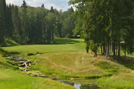 Tseleevo, Moscow region, Russia - July 24, 2014: Golf course in the Tseleevo Golf & Polo Club during the M2M Russian Open. The course was designed by Jack Nicklaus who is regarded as one of the most successful professional golfers of all time Stock Photo - 30215569