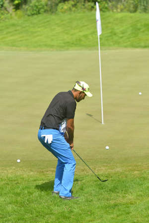 Tseleevo, Moscow region, Russia - July 24, 2014: James Ferraby of England in action in the Tseleevo Golf & Polo Club during the M2M Russian Open. This international golf tournament is the stage of the European Tour