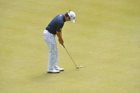 Tseleevo, Moscow region, Russia - July 24, 2014: Masahiro Kawamura of Japan in action in the Tseleevo Golf & Polo Club during the M2M Russian Open. This international golf tournament is the stage of the European Tour