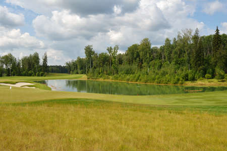 Tseleevo, Moscow region, Russia - July 24, 2014: Golf course in the Tseleevo Golf & Polo Club during the M2M Russian Open. The course was designed by Jack Nicklaus who is regarded as one of the most successful professional golfers of all time