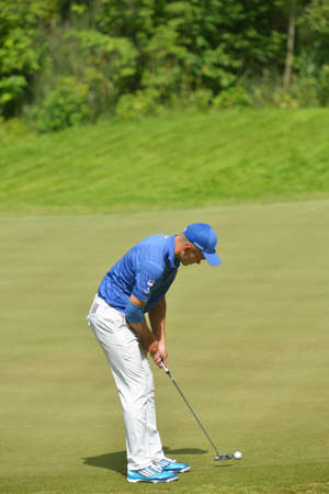 Tseleevo, Moscow region, Russia - July 24, 2014: Vladimir Osipov of Russia in action in the Tseleevo Golf & Polo Club during the M2M Russian Open. This international golf tournament is the stage of the European Tour