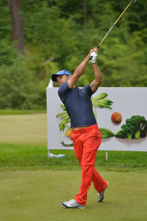 Tseleevo, Moscow region, Russia - July 24, 2014: Andrey Pavlov of Russia in action in the Tseleevo Golf & Polo Club during the M2M Russian Open. This international golf tournament is the stage of the European Tour