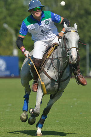 Tseleevo, Moscow region, Russia - July 26, 2014  Esteban Panelo of Moscow Polo club in action in the match against the team of British Schools during the British Polo Day  Moscow Polo Club won 7-6