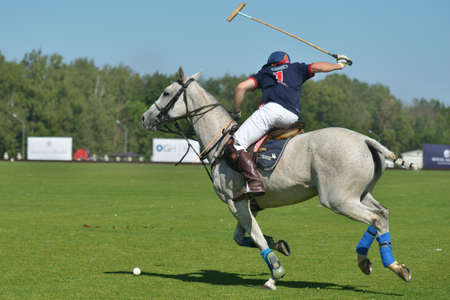 Tseleevo, Moscow region, Russia - July 26, 2014  Cameron Bacon of British schools in action in the match against Moscow Polo Club during the British Polo Day  Bacon become the best player of the match
