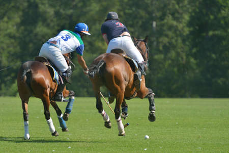 Tseleevo, Moscow region, Russia - July 26, 2014  Misha Rodzianko  left  of Moscow Polo Club and Ollie Browne of British Schools in action during the British Polo Day  Moscow Polo Club won 7-6