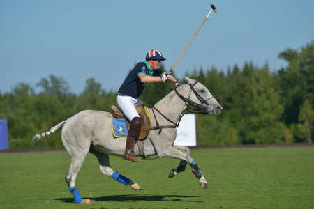 Tseleevo, Moscow region, Russia - July 26, 2014  Tom Hudson of Oxbridge Polo Team in action during the match against the Tseleevo Polo Club during the British Polo Day  Oxbridge won 5-4