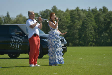 Tseleevo, Moscow region, Russia - July 26, 2014  Elena Romanova sings the anthem of UK during the opening ceremony of British Polo Day  It was the second British Polo Day in Russia Editorial