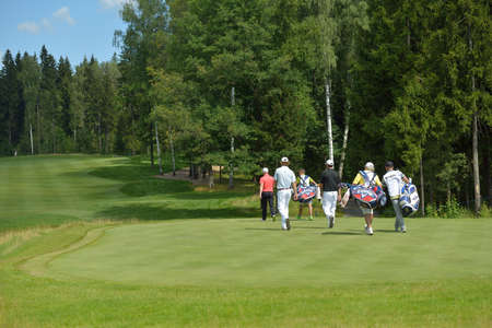 Tseleevo, Moscow region, Russia - July 26, 2014  Golfers on the golf course in the Tseleevo Golf   Polo Club during the M2M Russian Open  This international golf tournament is the stage of the European Tour