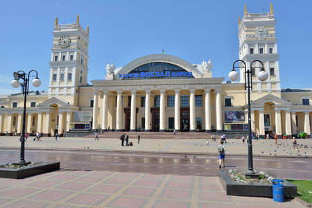 Kharkov, Ukraine - June 5, 2014  People in front of the building of the main railway station  The building opened in 1952 in place of the previous building destructed during the World War II