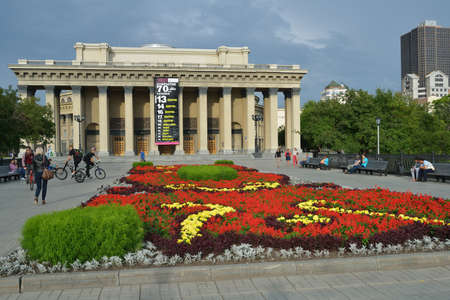 repertoire: Novosibirsk, Russia - July 30, 2014  People in front of the Novosibirsk Opera and Ballet Theater  It