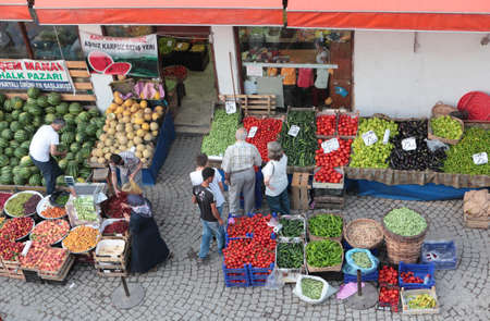 broader: Safranbolu, Turkey - June 23, 2012: People buy fruits and vegetables on the street market. Locals prefer to buy foods on the market due to cheaper prices and broader assortment Editorial