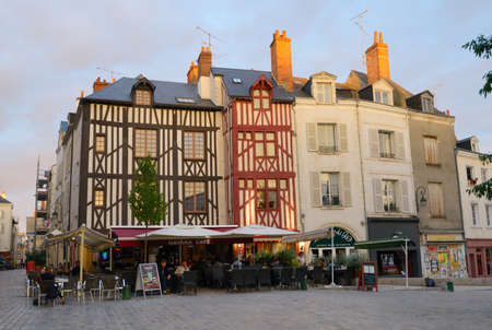 fachwerk: Orleans, France - September 10, 2013: People resting in the street cafe in the historic center of city. Orleans belongs to the Loire Valley sector, which was in 2000 inscribed by UNESCO as a World Heritage Site