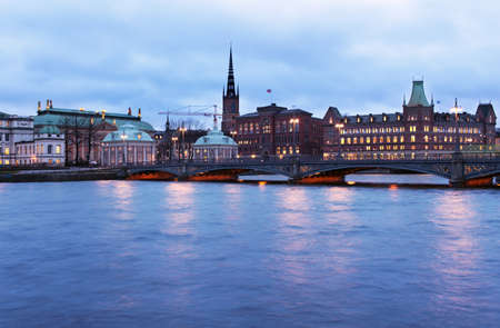 Stockholm, Sweden - January 4, 2011: View to the Vasabron bridge against Riddarholmen in evening. Built in 1878, the bridge is named after King Gustav Vasa
