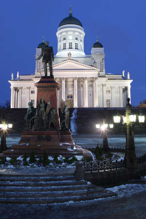 reestablishment: Helsinki, Finland - January 12, 2012: Monument to Russian Emperor Alexander II on the Senate square against Helsinki Cathedral. The statue, erected in 1894, was built to commemorate his re-establishment the Diet of Finland in 1863