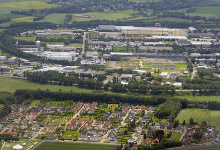 rhine westphalia: Dortmund, Germany - June 22, 2013: Aerial view to the plants of Brillux and other companies from the airplane. North Rhine-Westphalia has about 21.8 percent of the total German GDP and is the economically most important land in Germany Editorial