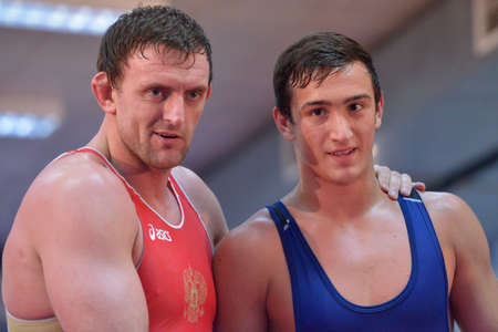 vasily: Novosibirsk, Russia - October 16, 2014: Greco-Roman wrestling World Cup winner Vasily Teploukhov (left) on the open training. The event aimed to promote the MMA Friendship Cup which took place on November 8
