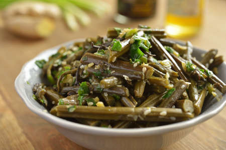 Sauteed bracken fern with sesame oil and seeds photo