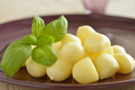 scamorza cheese: Scamorza cheese and basil on a plate