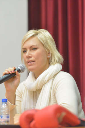 wba: Novosibirsk, Russia - November 8, 2014: World champion in boxing Natalia Ragozina talk with children. The meeting dedicated to the Friendship Cup and aimed to promote the sport