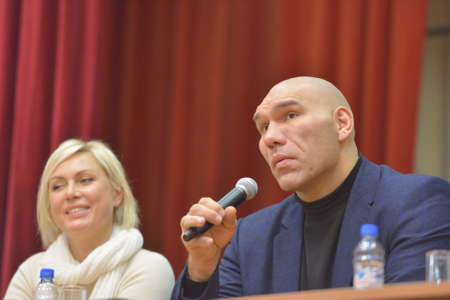 wba: Novosibirsk, Russia - November 8, 2014: World champions in boxing Nikolay Valuyev and Natalia Ragozina talk with children. The meeting dedicated to the Friendship Cup and aimed to promote the sport