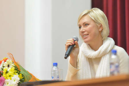 Novosibirsk, Russia - November 8, 2014: World champion in boxing Natalia Ragozina talk with children. The meeting dedicated to the Friendship Cup and aimed to promote the sport