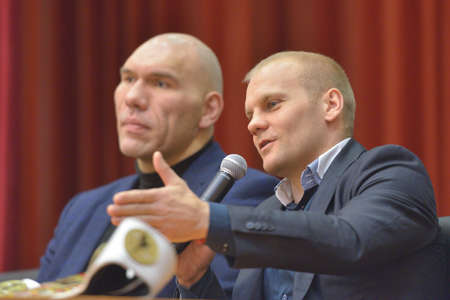 wba: Novosibirsk, Russia - November 8, 2014: World champion in kickboxing Semen Poskotin and WBA ex-World Champion Nikolay Valuyev talk with children. The meeting dedicated to the Friendship Cup and aimed to promote the sport