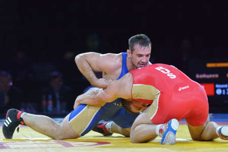 greco roman: Novosibirsk, Russia - November 8, 2014: Greco-Roman wrestling match Aslan Abdullin (blue singlet) vs Valery Gusarov during the Friendship Cup. The competitions include 10 kind of martial arts