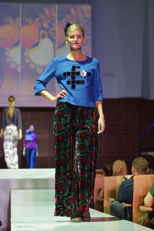 classics: Novosibirsk, Russia - November 15, 2014: Model dressed from Olga Buzytskaya on the Grand defile of Novosibirsk Fashion Week. The event was held under the motto High Fashion & High Classics