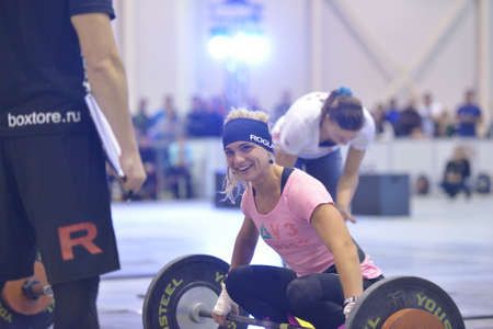 Novosibirsk, Russia - November 16, 2014: Unidentified female athlete during the International crossfit competition Siberian Showdown. The competition included in the program of the festival Siberian Health.