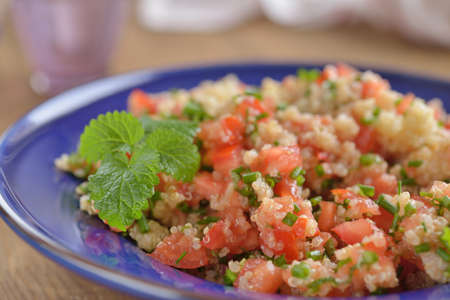 moroccan cuisine: Tabbouleh with quinoa, tomato, chives, and mint Stock Photo