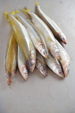 smelt: Raw smelt fishes on a table Stock Photo