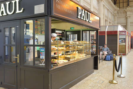 family owned: Bordeaux, France - June 27, 2013: Patisserie PAUL offers foods on the train station. Founded in 1889, now La Maison PAUL still is the family owned company presented in 25 countries Editorial