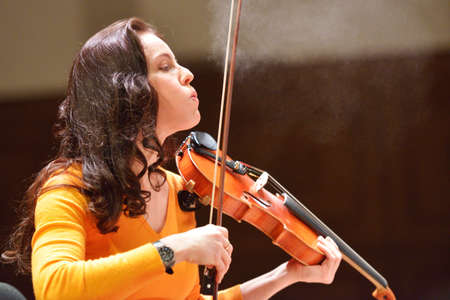 joins: Novosibirsk, Russia - December 5, 2014: Arina Shevliakova, the first violin of the ensamble Moscow Soloists on the rehearsal during the festival Classics. The festival joins the concerts of the World music stars Editorial