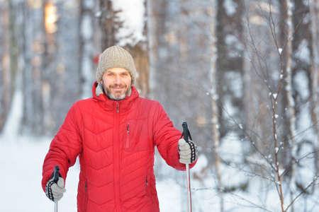 nordic ski: Mature man cross-country skiing