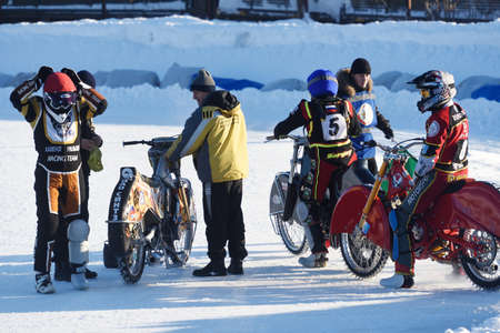 individual sport: Novosibirsk, Russia - December 20, 2014: Unidentified bikers before the semi-final individual rides of Russian Ice Speedway Championship. The sports returns to the sport arenas after a decline
